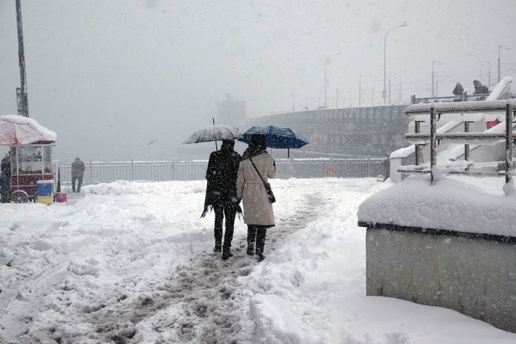 Couple walking with umbrellas in snowy weather in Istanbul in winter 2017 Cold Temperature Couple Couple With Umbrellas Covered In Snow Istanbul Winter 2017 Outdoors People Walking  Real People Snow Snow Covered Snowing Snowy Day ❄ Warm Clothing Weather Winter Winter In Istanbul Winter Landscape Winter Wonderland Wintertime