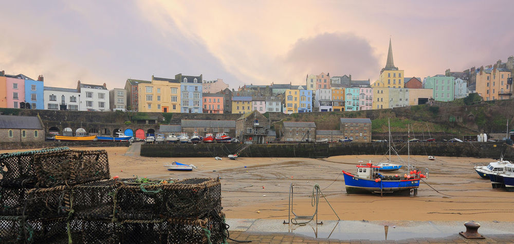Tenby Harbour in South Wales Pembroke South Tenby Wales Architecture Building Exterior Built Structure City Cityscape Cloud - Sky Day Fishing Hrbour Bull Moored Nature Nautical Vessel No People Outdoors Resort Seaside Sky Sunset Transportation Tree Water