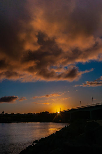Spanish Landing Ntc / Trail Sunset Sky Water Cloud - Sky Beauty In Nature Scenics - Nature Orange Color Nature Tranquil Scene Tranquility No People Silhouette Dramatic Sky Bridge Idyllic River Outdoors Transportation Non-urban Scene