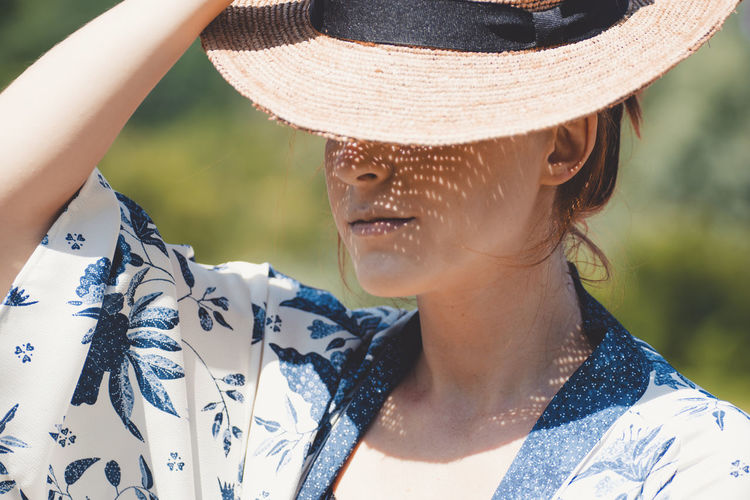 Close-Up Of Woman Wearing Hat During Sunny Day