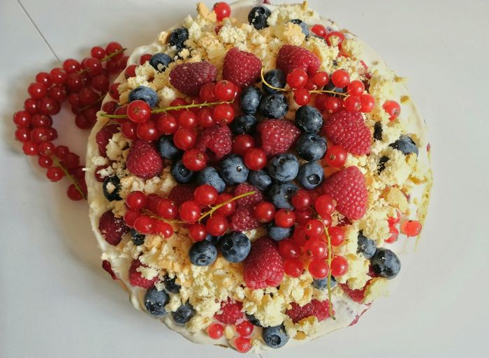 High Angle View Of Fruits On Cake