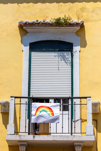View of yellow house on window of building