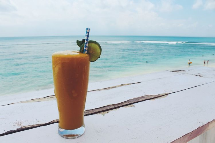 Bali INDONESIA Beach Cocktail Drink Drinking Glass Drinking Straw Food And Drink Freshness Fruit Juice Glass Healthy Eating Horizon Horizon Over Water Household Equipment Nature No People Non-alcoholic Beverage Outdoors Refreshment Sea Sky Straw Water