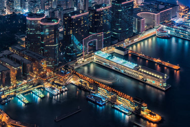 High angle view of illuminated harbor in city at night