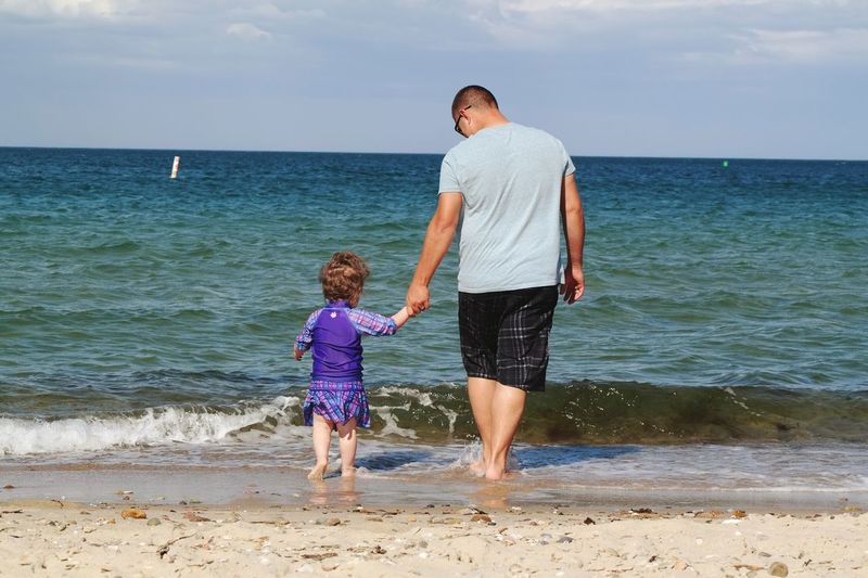 Full length of girl standing on beach