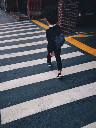 Directional gait Street Fashion Motion Streetphotography Crosswalk Waliking  Road City Crossing Crosswalk Zebra Crossing Road Marking Streetwise Photography Street One Person Architecture Lifestyles Full Length Walking Sign Outdoors Real People Streetwise Photography