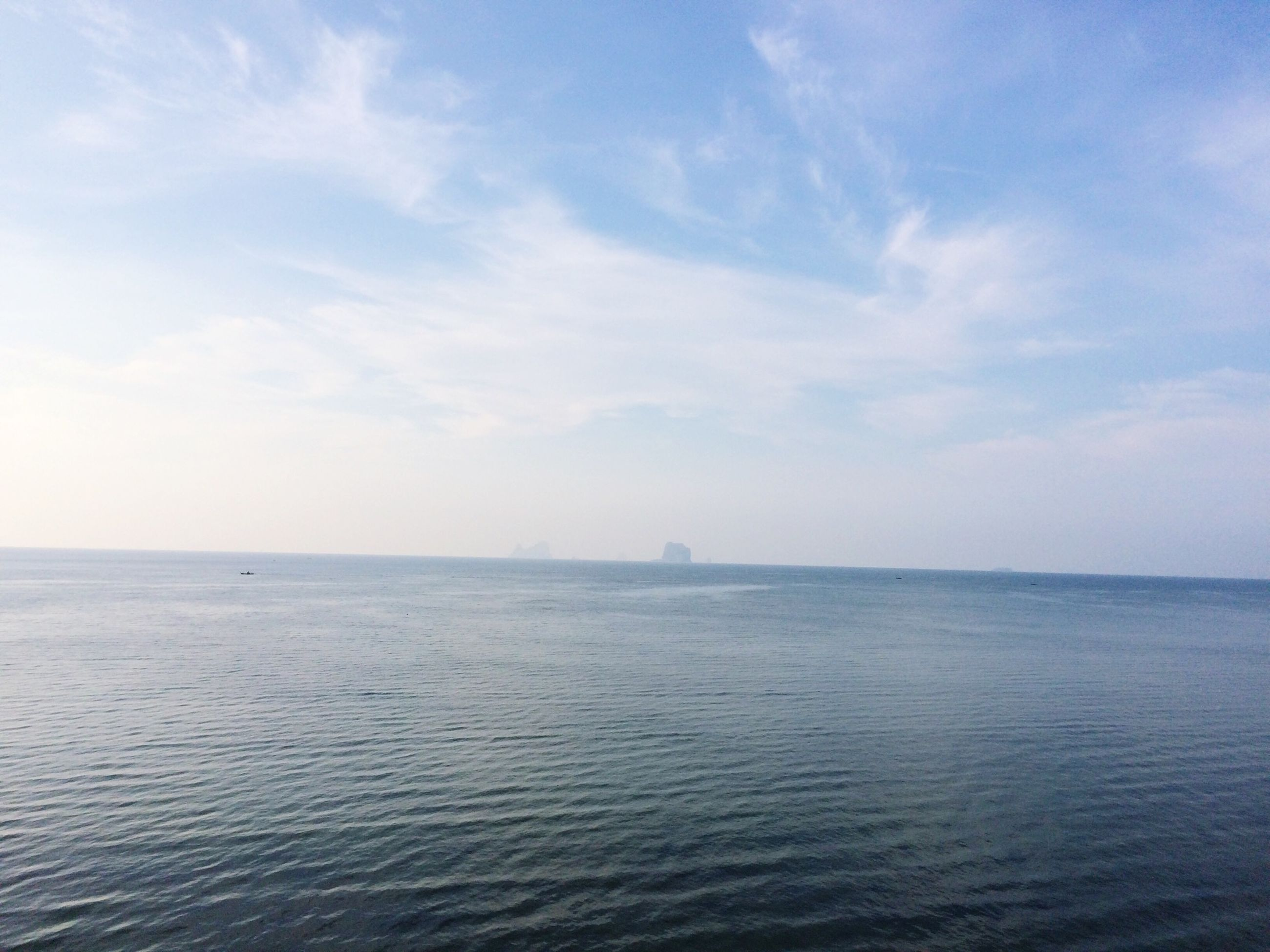 sea, water, waterfront, tranquil scene, horizon over water, sky, tranquility, scenics, beauty in nature, rippled, nature, seascape, cloud - sky, idyllic, blue, cloud, day, outdoors, no people, calm