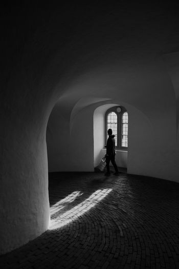 Light And Shadow Window Silhouette Architecture And People Street Photography Arch Architecture One Person Real People Built Structure Lifestyles Full Length Indoors  The Past History