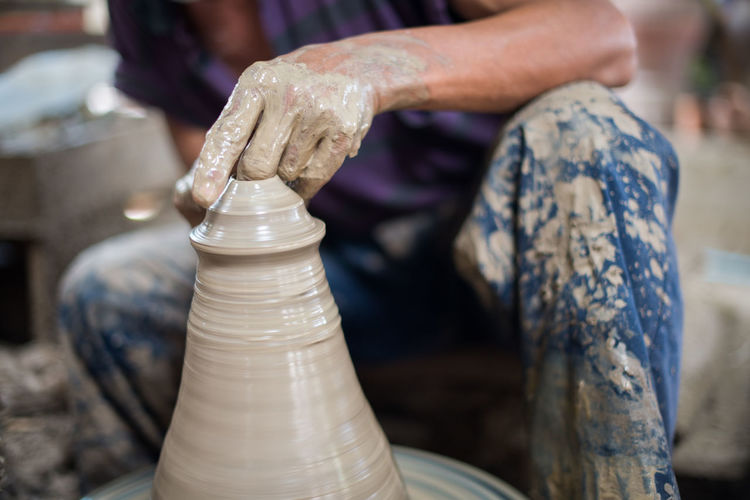 Porcelain  Art And Craft Ceramics Clay Close-up Craft Creativity Dirt Earthenware Expertise Focus On Foreground Hand Human Body Part Human Hand Making Molding A Shape Mud Occupation One Person Pottery Preparation  Sculptor Skill  Spinning Working
