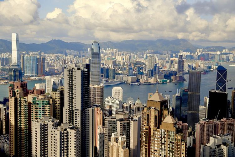 Cityscape Skyscraper Built Structure City Architecture Building Exterior Tower Water Travel Destinations Tall - High Building Story Development City Life Mountain Modern Wide Shot Office Building River Waterfront Crowded Hong Kong