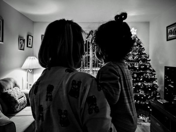 Dans les bras de grand-maman Grandmother Grandchild christmas tree Christmas Time Pyjamas Celebration Indoor Photography Christmas Spirit Holding Baby Little Girl Motherhood Google Pixel Blackandwhite The Week on EyeEm Quebec Lights Togetherness Bonding Women Standing Love Christmas Ornament Christmas Decoration Christmas Lights