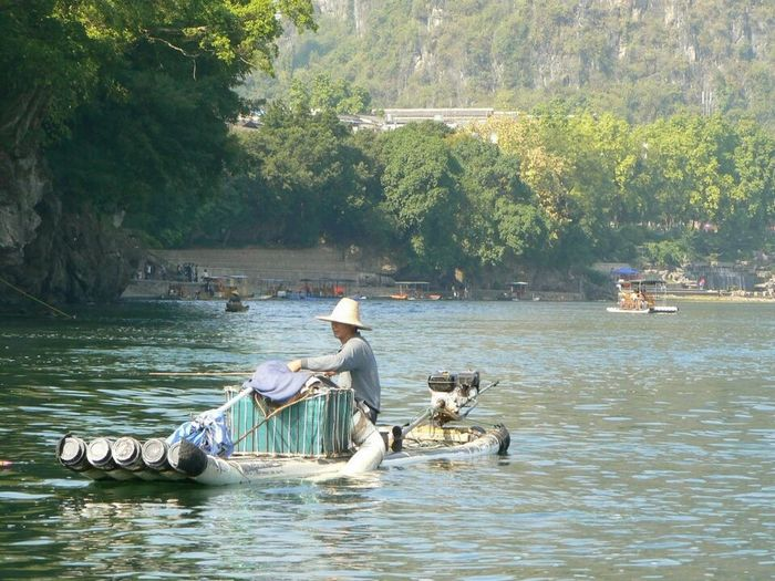 Transportation Water River Occupation Real People Fishing Fisherman Fishing Boat China