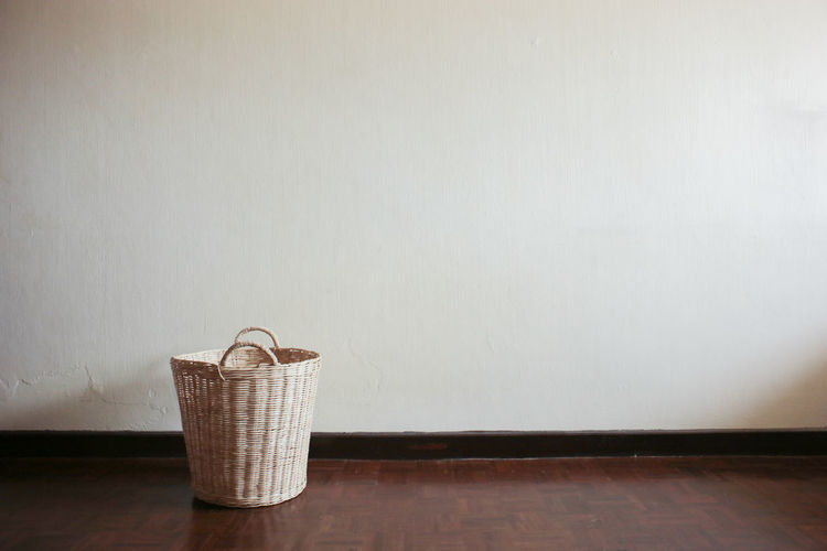Close-Up Of Wicker Basket By Wall