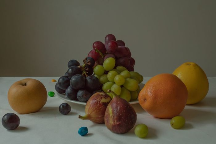 """Still Life with Fruits, August"" As bland as it seems, there's always something that throws you off in our everyday lives; these series of still life photos capture the true nature of matters by overemphasizing and staging a microscopic moment in an odd and unsettling manner. Food And Drink Food Fruit Healthy Eating Freshness Wellbeing Grape Still Life Indoors  Table No People Citrus Fruit Studio Shot Orange Color Red Grape The Still Life Photographer - 2018 EyeEm Awards The Creative - 2018 EyeEm Awards The Still Life Photographer - 2018 EyeEm Awards"