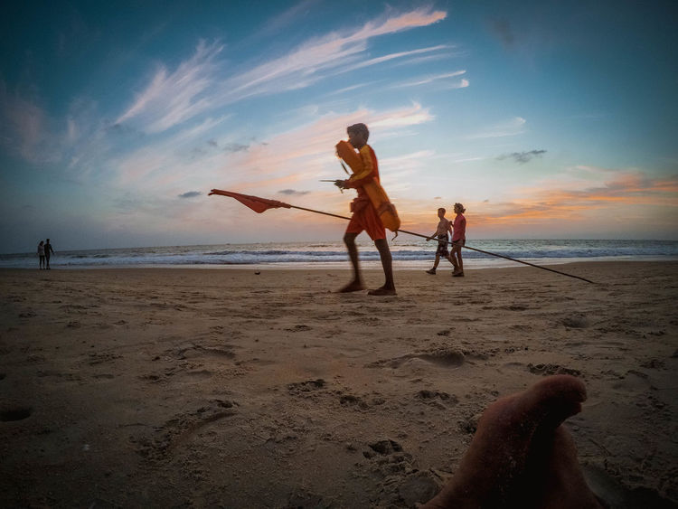 Lifeguard Beach Sand Sea Vacations People Sky Water Full Length Horizon Over Water Fisherman Fishing Net Togetherness Boys Outdoors Sunset Child Men Nature Adult Human Body Part Lifeguard  Goa ❤❤ EyeEmNew Here EyeEmNewHere