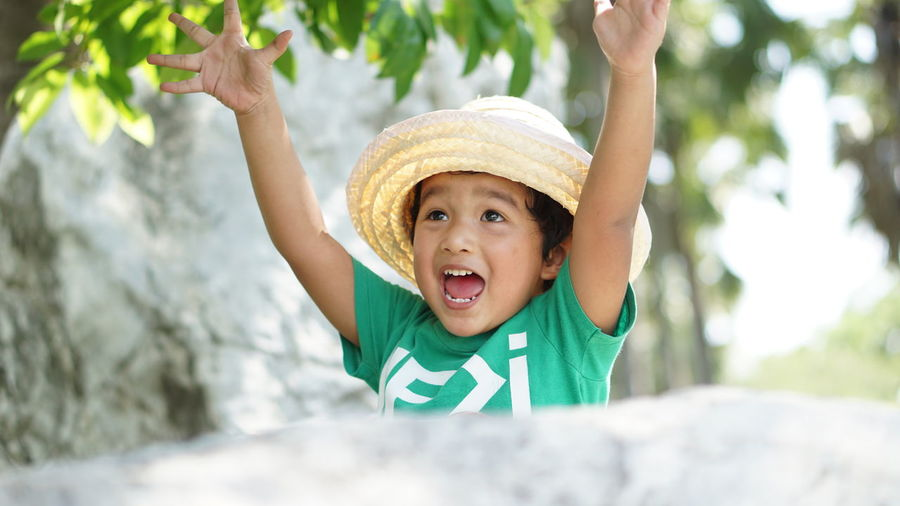 Portrait of boy wearing hat in park