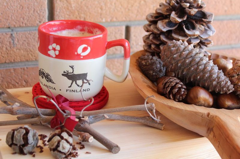 Close-up of coffee with pine cones on table