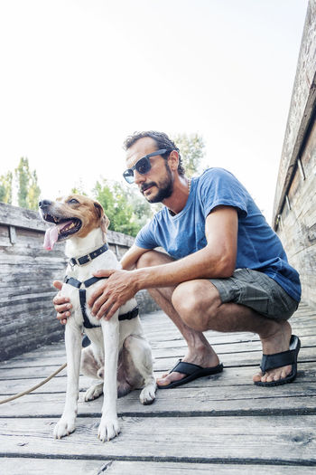 Man with dog on footbridge