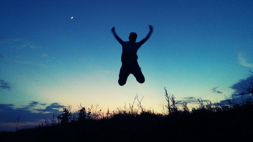 Mobile Phone Photography Silhouette Jumping Mid-air Sunset Dusk One Person Sky Moon Adults Only Blue Adult People Men Outdoors One Man Only Only Men Full Length Nature Human Body Part Energetic Mobile Photography