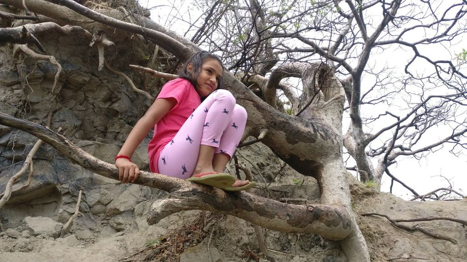 Girls Children Only Fun Happiness Tree Climbing Smiling Leisure Activity Childhood Child Full Length Elementary Age Casual Clothing Day Outdoors Sand One Person Enjoyment One Girl Only People EyeEmNewHere EyeEm Selects
