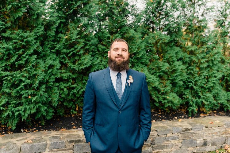 Portrait of man standing against plants