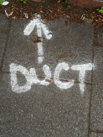 Duct Pavement This Way Information Street Works Before Digging Up Text Preparation  Spraypaint Word Ground Pivotal Ideas