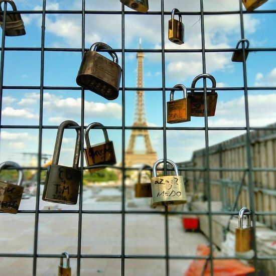 Hanging Metal Security Padlock Protection Safety Lock Sky Outdoors Love Lock Day No People Hope - Concept Close-up Cityscape City Adult Lovelife Lovelocks Love Life Love Locks Love Love And Love❤ Love Paris Effiletower Metal Work