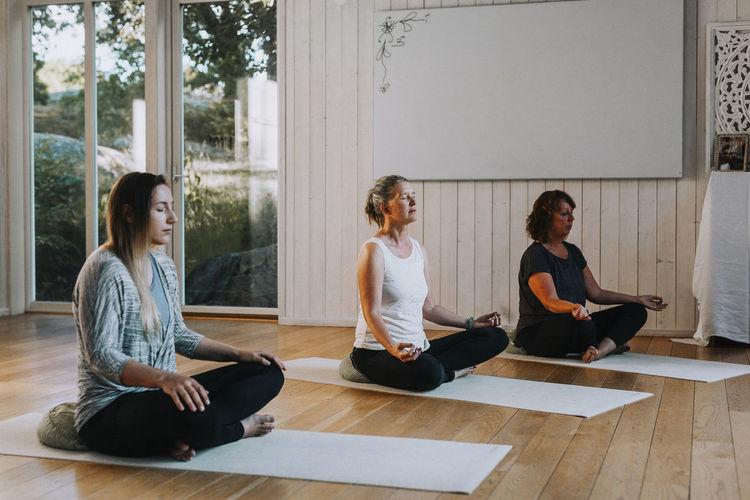 Women sitting on wooden floor