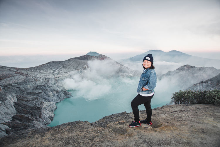 INDONESIA Beauty In Nature Casual Clothing Full Length Idyllic Kawah Ijen Leisure Activity Lifestyles Mountain Mountain Range Nature Non-urban Scene One Person Outdoors Real People Scenics - Nature Sky Standing Tourism Tranquil Scene Travel Destinations Water Young Adult Young Women