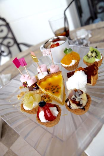 High Angle View Of Various Dessert Served On Table