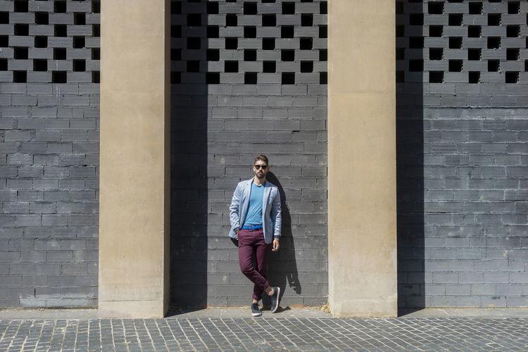 Full length of a man walking in city