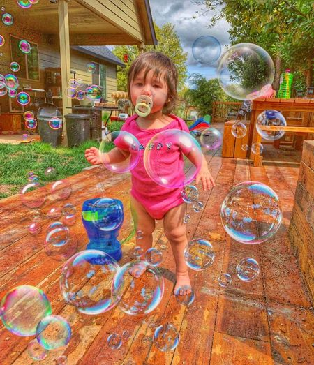 1yr Old Bubbles Having Fun Naomi Mynome BubbleBaby POP! Outdoor Photography Bubbles Collection Bubble Photography Bubble Play Playing Playing Outside Bubble Wand Child Full Length Childhood Smiling Happiness Water Multi Colored Playing Motion Soap Sud Bubble Soap Outdoor Play Equipment Preschooler Children Wet