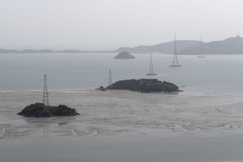 view at Bomunsa, a famous Buddhism temple in Seokmodo, Kimpo, Gyeonggido, South Korea Bomunsa Buddhism Temple Seokmodo South Korea South Korea🇰🇷 Beauty In Nature Buddhism Day Fog Land Mountain Nature Nautical Vessel No People Non-urban Scene Outdoors Religion Rock Sailboat Scenics - Nature Sea Sky Temple Tranquil Scene Tranquility Transportation Water