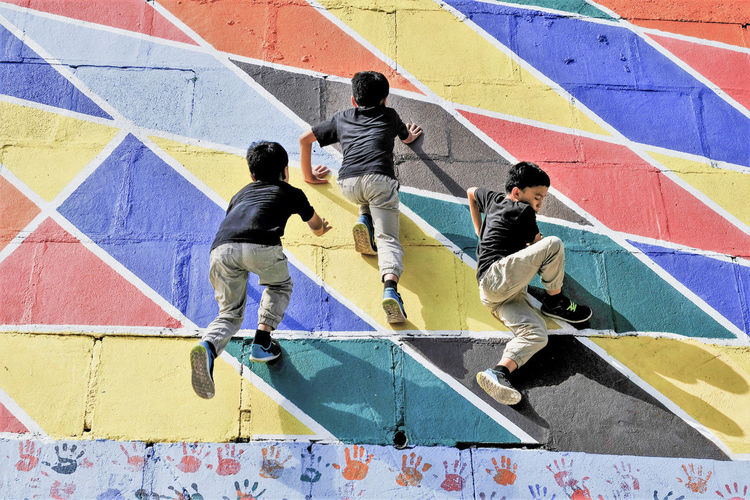 High Angle View Multi Colored Men Group Of People People Architecture Real People Art And Craft Graffiti Day Lifestyles Wall - Building Feature Creativity Sport Full Length Rear View Leisure Activity Built Structure Child Togetherness Outdoors