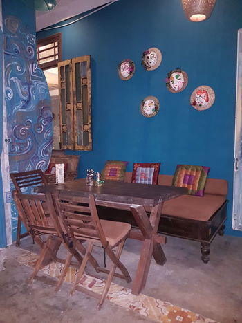 Vietnamese Restaurant Chair Table Window Reataurant Vietnam Art Blue Seat Sitting Bank Postcard Chair Indoors  Table Painted Image Furniture No People Day