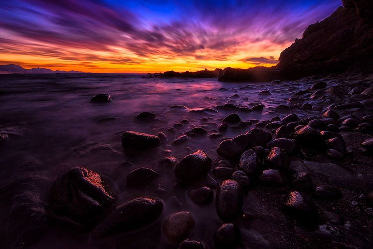 rainbow skies Beach Beauty In Nature Cloud - Sky Horizon Horizon Over Water Idyllic Land Nature No People Purple Rock Rock - Object Scenics - Nature Sea Sky Solid Sunset Sunset #sun #clouds #skylovers #sky #nature #beautifulinnature #naturalbeauty #photography #landscape Tranquil Scene Tranquility Water
