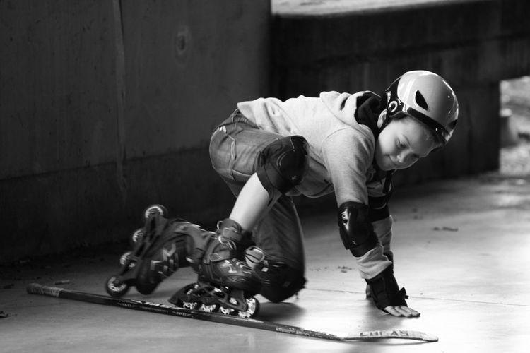 Boy practicing inline skating