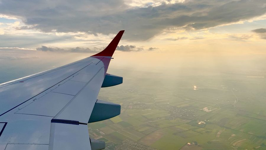Airplane Air Vehicle Cloud - Sky Sky Mode Of Transportation Transportation Flying Aircraft Wing Beauty In Nature Scenics - Nature Environment Landscape Nature Travel Aerial View No People Mid-air on the move Sunset Motion Outdoors Winglet Wingview Wing View