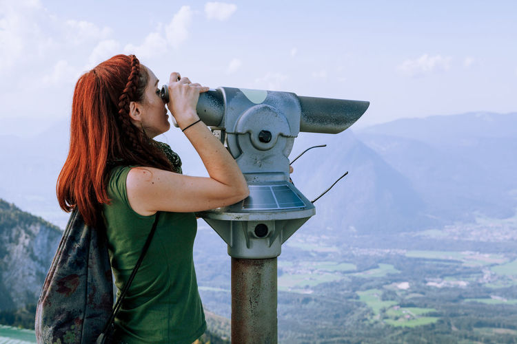 Mountain Real People One Person Nature Lifestyles Young Women Beauty In Nature Mountain Range Sky Day Scenics - Nature Young Adult Leisure Activity Standing Holding Side View Binoculars Women Non-urban Scene Hairstyle Hair Outdoors Astronomy Redhead EyeEm Nature Lover