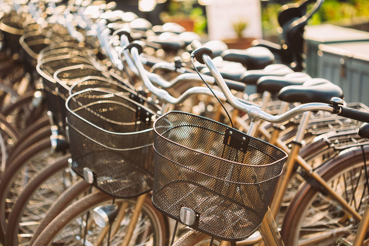 Close-Up Of Bicycles Parked In Row At City