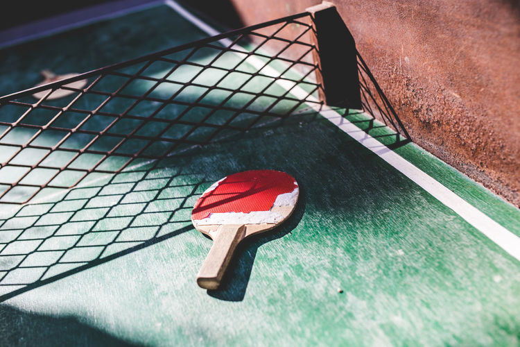 High angle view of tennis racket on table