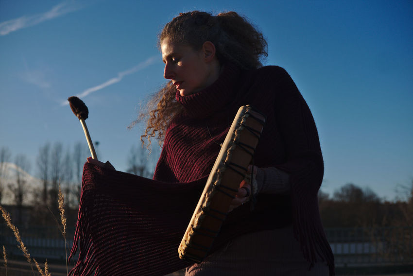 Potrait of Raphaela Gilla with her shaman drum Adult Adults Only Close-up Day Music Musical Instrument Musician One Person Outdoors People Playing Potrait Potrait Of Woman Potrait_photography Shaman Shaman Drum Shamanic Shamanism Shamans_photo Sky Wild Young Adult
