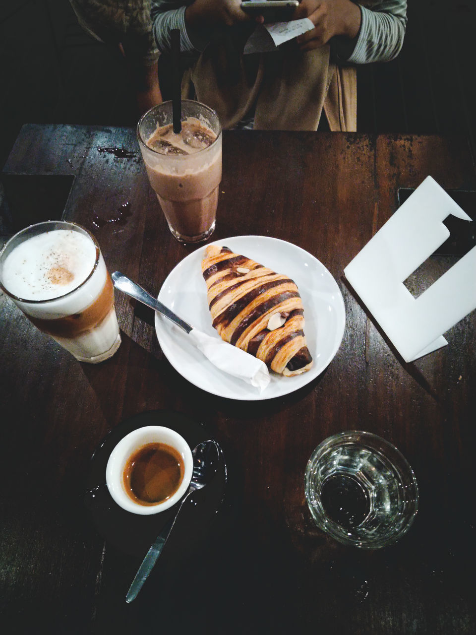 food and drink, drink, refreshment, table, coffee, coffee - drink, freshness, food, indoors, drinking glass, glass, household equipment, cup, still life, coffee cup, high angle view, sweet food, ready-to-eat, indulgence, mug, no people, frothy drink, temptation, crockery