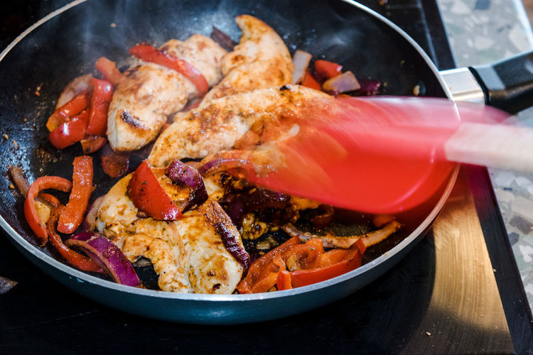 CLOSE-UP OF MEAL BEING PREPARED IN PAN