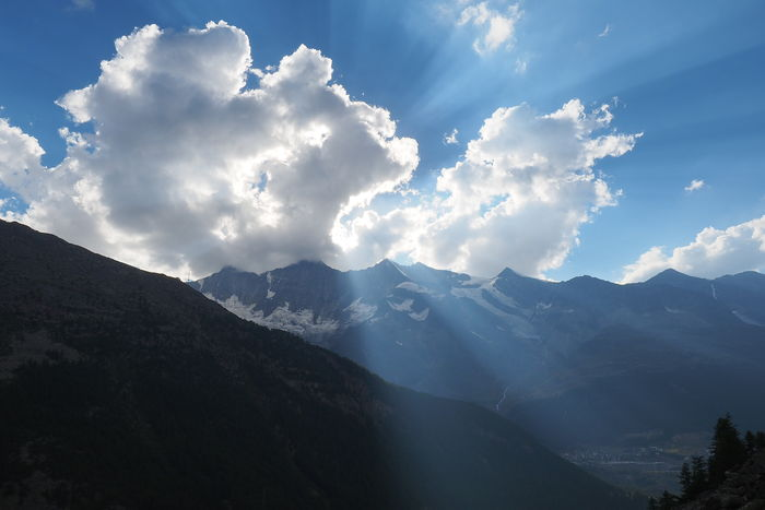 Sun breaking through clouds in the Swiss alps Alps Beauty In Nature Clouds And Sky Mountain Nature No People Outdoors Sky Hope
