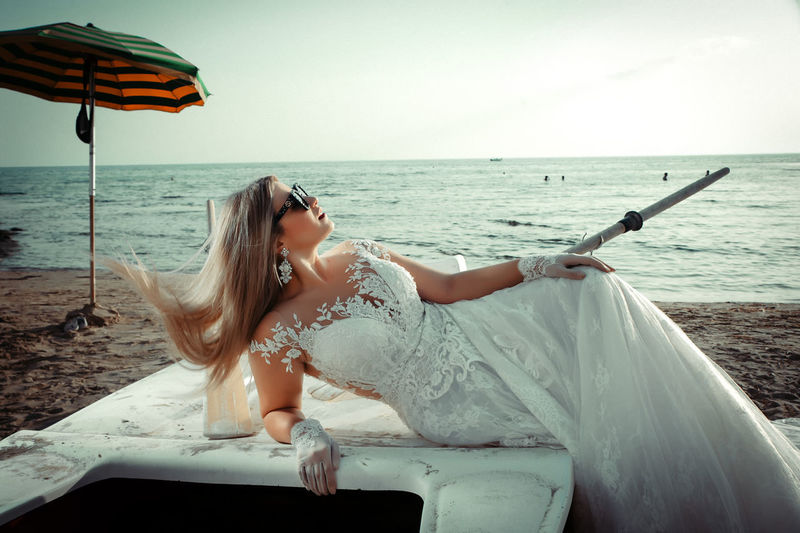Beach Beautiful Woman Beauty In Nature Day Fashion Hairstyle Horizon Horizon Over Water Land Leisure Activity Lifestyles Nature One Person Outdoors Real People Relaxation Sea Sitting Sky Water Young Adult Young Women