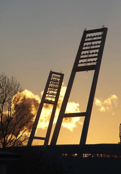 Masts of Soccer Stadium Weserstadion at sun rising, Bremen, Germany Bremen Football German Rising Sun Soccer Stadium Sunset Werder