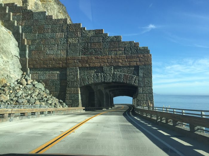 Route 1 Architecture Built Structure Transportation Sky Nature No People History The Past The Way Forward Day Travel Destinations Water Direction Arch Sea Connection Cloud - Sky Road Railing Outdoors Ancient Civilization Stone Wall