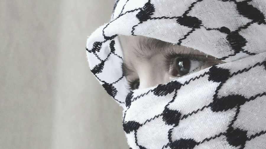 Close-up of woman with covered face