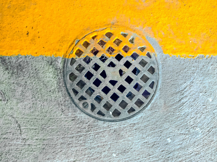 Directly above shot of manhole on footpath